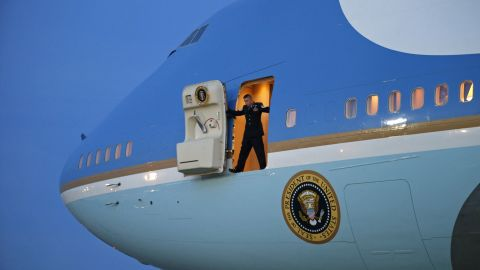 A crew member stands in the door of Air Force One as he waits for stairs to arrive Thursday, January 8, at Joint Base Andrews in Maryland. President Barack Obama was returning from a two-day trip to Michigan and Arizona.