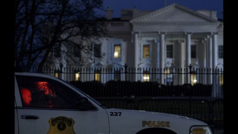 """A member of the Secret Service's Uniformed Division sits in his car outside the White House after a small drone <a href=""""http://www.cnn.com/2015/01/26/politics/white-house-device-secret-service/"""" target=""""_blank"""">crashed on the premises</a> Monday, January 26. The drone posed no threat, said a spokesman for President Obama, and Obama was in India at the time. The drone's owner and operator worked for the National Geospatial-Intelligence Agency, a government entity with mapping and national security duties. The agency confirmed that one of its employees was the operator of the drone, saying the employee was off-duty and the drone flight was not work-related."""