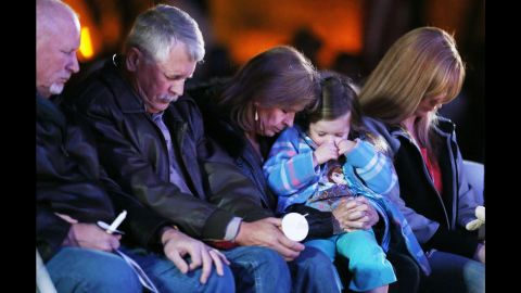 """Carl Mueller, second from left, sits next to his wife, Marsha, as they honor their daughter Kayla with a candlelight vigil in Prescott, Arizona, on Wednesday, February 18. Kayla, a 26-year-old American aid worker, <a href=""""http://www.cnn.com/2015/02/10/world/isis-hostage-mueller/index.html"""" target=""""_blank"""">was killed by the militant group ISIS.</a> She had been captured in northern Syria in 2013."""