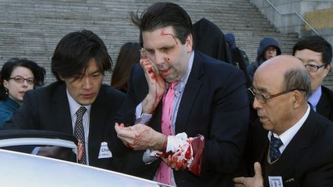 """Mark Lippert, the U.S. ambassador to South Korea, leaves for a hospital after he was attacked Thursday, March 5, in Seoul, South Korea. According to Seoul police, Lippert <a href=""""http://www.cnn.com/2015/03/04/politics/ambassador-attacked-south-korea/index.html"""" target=""""_blank"""">was slashed on his right cheek and hand</a> with a knife measuring about 10 inches long. The attacker, Kim Ki-Jong, <a href=""""http://www.cnn.com/2015/09/10/asia/south-korean-stabbing-sentence-u-s-ambassador/"""" target=""""_blank"""">was convicted of attempted murder in September</a> and sentenced to 12 years in prison."""