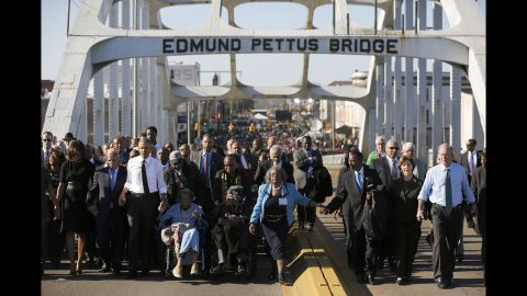 """President Barack Obama, on the left in the white shirt, and former President George W. Bush, on the far right, march across the Edmund Pettus Bridge in Selma, Alabama, on Saturday, March 7. Their wives also joined them for the event, which was held 50 years after <a href=""""http://www.cnn.com/2015/01/06/us/gallery/selma-bloody-sunday-1965/index.html"""" target=""""_blank"""">marchers were brutally beaten</a> as they demonstrated for voting rights."""