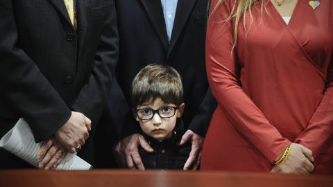 """Hayden Lewis, cousin of Sandy Hook shooting victim Jesse Lewis, stands with his family during a news conference in Hartford, Connecticut, on Monday, April 13. Connecticut's congressional delegation backed federal legislation that would provide expanded support to train teachers in social and emotional learning. """"If the shooter, in our case, had access to this type of learning before the tragedy at Sandy Hook, it might not have happened,"""" said Jesse's mother, Scarlett. Twenty-six people -- 20 students and six adults -- <a href=""""http://www.cnn.com/interactive/2012/12/us/sandy-hook-timeline/"""" target=""""_blank"""">were shot and killed</a> by 20-year-old Adam Lanza in December 2012."""