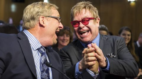 Singer Elton John, right, greets pastor Rick Warren on Wednesday, May 6, prior to testifying before a Senate subcommittee in Washington. The singer supports U.S. funding for the global treatment for HIV and AIDS.