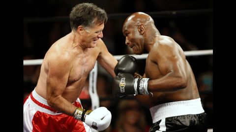 """Former presidential candidate Mitt Romney, left, <a href=""""http://www.cnn.com/2015/05/16/politics/mitt-romney-boxing-evander-holyfield-rumble/"""" target=""""_blank"""">boxes former heavyweight champion Evander Holyfield</a> during a charity event Friday, May 15, in Salt Lake City. The bout raised money for CharityVision, an organization that provides surgeries to heal blindness."""