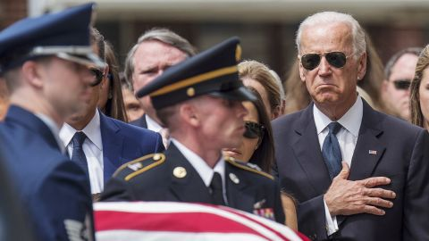 """Vice President Joe Biden places his hand over his heart as the casket of his late son, former Delaware Attorney General Beau Biden, is carried into a church in Wilmington, Delaware, for <a href=""""http://www.cnn.com/2015/06/04/politics/gallery/beau-biden-wake/index.html"""" target=""""_blank"""">a funeral</a> on Saturday, June 6. Beau Biden died of brain cancer at the age of 46."""