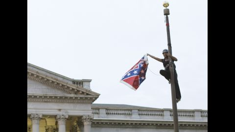 """Bree Newsome <a href=""""http://www.cnn.com/2015/06/27/politics/south-carolina-confederate-flag/"""" target=""""_blank"""">removes the Confederate battle flag</a> from a monument in front of the South Carolina State House on Saturday, June 27. She was charged with defacing a monument, and a new flag went up within about an hour, according to the South Carolina Department of Public Safety. Not long after she was led away in handcuffs, Newsome became an online hero, a trending topic on social media and the subject of an online fundraiser. South Carolina took down the flag on its own in July, <a href=""""http://www.cnn.com/2015/07/10/us/south-carolina-confederate-battle-flag/"""" target=""""_blank"""">ending a 54-year run</a> on the Capitol grounds."""
