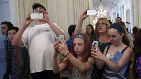 People take photos while touring the White House on Wednesday, July 1. It was the first day the White House began allowing photos to be taken during public tours.