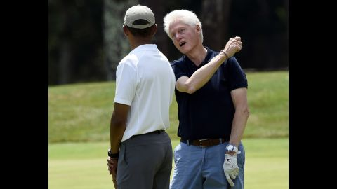 """President Obama plays golf with former President Bill Clinton during <a href=""""http://www.cnn.com/2015/08/17/politics/gallery/obama-golf-marthas-vineyard/index.html"""" target=""""_blank"""">his vacation</a> to Martha's Vineyard, an island in Massachusetts, on Saturday, August 15."""