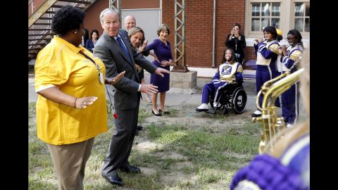 Former President George W. Bush dances along with the Warren Easton High School marching band during a trip to New Orleans on Friday, August 28. Bush's visit came as the city prepared to mark the 10th anniversary of Hurricane Katrina.