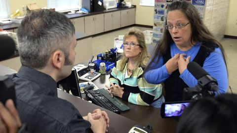 """Rowan County Clerk Kim Davis, right, talks with David Moore after she refused him a marriage license in Morehead, Kentucky, on Tuesday, September 1. Davis <a href=""""http://www.cnn.com/2015/09/14/politics/kim-davis-same-sex-marriage-kentucky/index.html"""" target=""""_blank"""">was eventually jailed</a> for refusing to issue marriage licenses to same-sex couples. She said same-sex marriages violated her Christian beliefs. After her release, she said she would not issue any marriage licenses that go against her religious beliefs. But she left the door open for her deputies to give out marriage licenses to same-sex couples as long as those documents do not have her name or title on them."""
