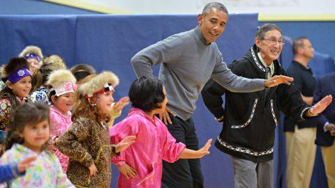 President Obama dances with children after attending a cultural performance in Dillingham, Alaska, on Wednesday, September 2.