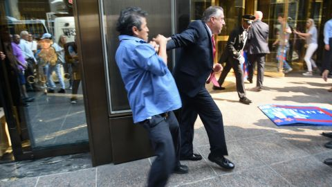 """Keith Schiller, Donald Trump's director of security and longtime bodyguard, holds back demonstrator Efrain Galicia at Trump Tower in New York on Thursday, September 3. Galicia was among five protesters who later <a href=""""http://www.cnn.com/2015/09/09/politics/donald-trump-protesters-lawsuit/"""" target=""""_blank"""">filed a lawsuit</a> against Schiller, Trump, Trump's campaign and his company. The plaintiffs allege that Trump security officials, namely Schiller, assaulted them as they protested outside of a campaign event."""