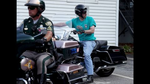 Wisconsin Gov. Scott Walker rides a motorcycle as he arrives at an Elk's Lodge in Salem, New Hampshire, on Monday, September 7. He was a presidential candidate at the time.