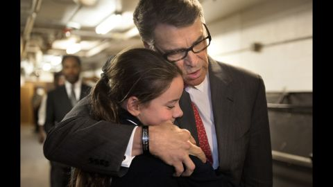 """Former Texas Gov. Rick Perry embraces Madeline Martin, daughter of Eagle Forum President Ed Martin, before speaking at the Eagle Council XLIV in St. Louis on Friday, September 11. During his speech, Perry became the first major presidential candidate <a href=""""http://www.cnn.com/2015/09/11/politics/rick-perry-2016-campaign-suspended/index.html"""" target=""""_blank"""">to drop out of the 2016 race.</a>"""