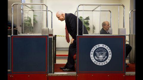 U.S. Sen. John McCain gets on the U.S. Capitol's subway system Wednesday, September 30, in Washington.