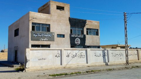 """ISIS' courthouse in Al-Houl, previously a school. The building also housed offices for an ISIS charity, with empty boxes marked """"shoes"""" sent from an Islamic charity in Durban, South Africa."""