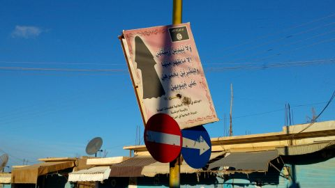 A sign left by ISIS on the main street in Al-Houl urging -- or perhaps better, ordering -- women to be completely veiled.
