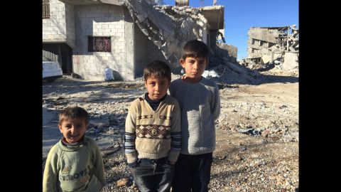The Muhajar brothers -- Yusif, 3, Mustafa, 8, and Ali, 11 -- in front of their partially destroyed house in Kobani. As someone pointed out to CNN's Ben Wedeman, the expressions from youngest to oldest go from smiling to frowning.