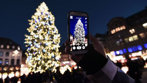 Twinkling lights, mulled wine, sweets, savories and festive handicrafts lure visitors to Christmas markets across Europe. Here, a visitor captures a dazzling centerpiece at the Christmas market in Strasbourg, the largest and one of the oldest French Christmas markets. Click through the gallery to see more markets: