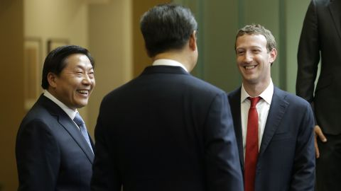Chinese President Xi Jinping (C) talks with Facebook Chief Executive Mark Zuckerberg (R) as Lu Wei, China's then-internet czar, looks on, during a gathering of CEOs and other executives in September 2015.