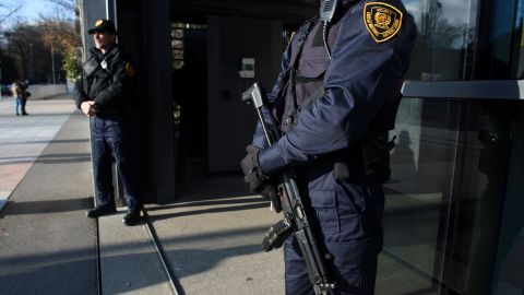 Security forces stand guard at the entrance of the United Nations headquarter in Geneva on December 10, 2015 after Swiss police declared actively searching the city for suspects who may be linked to last month's attacks in Paris. / AFP / Richard Juilliart        (Photo credit should read RICHARD JUILLIART/AFP/Getty Images)