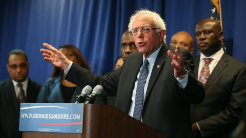 BALTIMORE, MD - DECEMBER 08:  Democratic presidential candidate Sen. Bernie Sanders, (I-VT) speaks while flanked by African-American religious and civic leaders after a meeting at the Freddie Gray Youth Empowerment Center, December 8, 2015 in Baltimore, Maryland. Earlier in the day Sanders toured the Sandtown-Winchester neighborhood where Freddie Gray lived and was arrested.  (Photo by Mark Wilson/Getty Images)