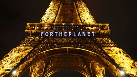 """The slogan """"FOR THE PLANET"""" is projected on the Eiffel Tower as part of the COP21, United Nations Climate Change Conference in Paris, France, Friday, Dec. 11, 2015.  (AP Photo/Francois Mori)"""