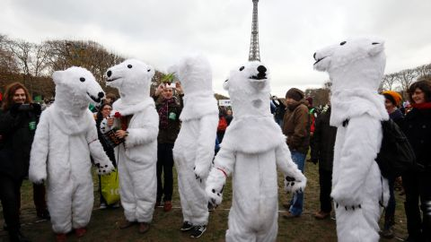 Demonstrators dressed-up as polar bears take part to a climate rally in Paris on Saturday.