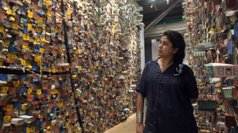 """Indian artist Hema Upadhyay poses in front of her """"Think Left, Think Right, Think Low, Think Tight"""" installation at the Paris's Pompidou Centre on May 23, 2011."""