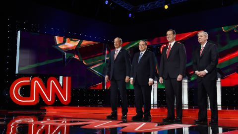 Republican presidential candidates George Pataki, Mike Huckabee, Rick Santorum and Sen. Lindsay Graham are introduced during the CNN presidential debate at The Venetian Las Vegas on December 15, 2015.