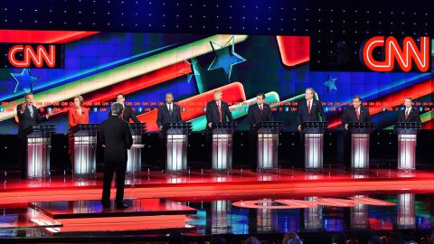 Republican presidential candidate Ohio Governor John Kasich (L) speaks during the Republican Presidential Debate, hosted by CNN, at The Venetian Las Vegas on December 15, 2015 in Las Vegas, Nevada.