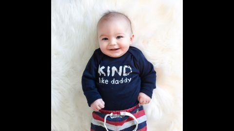 """You can't start teaching kindness too early! """"Kind Like Daddy"""" is the message of this infant <a href=""""http://www.freetobekids.com/"""" target=""""_blank"""" target=""""_blank"""">Free to Be Kids</a> T-shirt."""