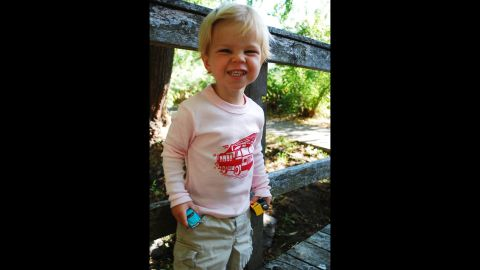 """This <a href=""""http://www.handsomeinpink.com/"""" target=""""_blank"""" target=""""_blank"""">Handsome in Pink</a> T-shirt includes a red firetruck on a light pink shirt."""