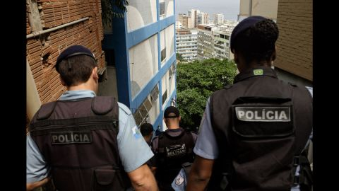 """A Police Pacification Unit monitors the Cantagalo favela. Launched in 2008, the """"pacification"""" program has been put in place in nearly 40 favelas and has received mixed reviews. It was designed to limit the reach of armed drug gangs by installing permanent police posts within the favelas where they typically operated."""