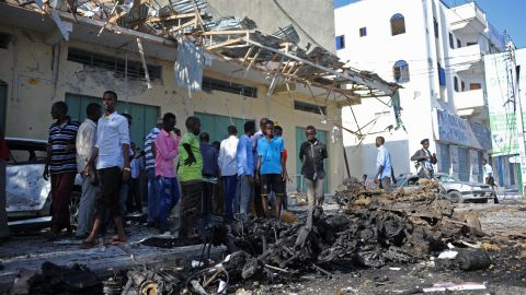 People gather at the site of a deadly bomb blast in Mogadishu on Saturday,