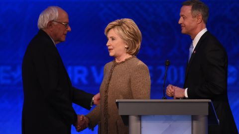 US Democratic presidential hopefuls (L-R) Bernie Sanders, Hillary Clinton and Martin O'Malley greet each other following the Democratic Presidential Debate hosted by ABC News at Saint Anselm College in Manchester, New Hampshire, on December 19, 2015.