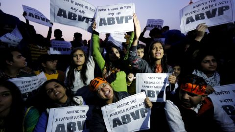 Activists hold signs and shout slogans demanding the death penalty for a convicted rapist during a protest against his release at India Gate in New Delhi on Sunday, December 20, 2015. Because the man was under 18 when the crime occurred, Indian law says he couldn't be given a sentence longer than three years.