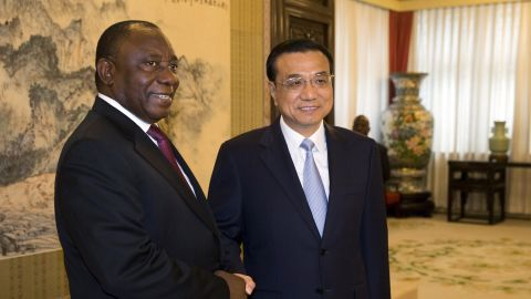 Ramaphosa (L) shakes hands with Chinese Premier Li Keqiang in 2015.