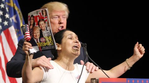 """Trump invites Colombian-born super fan Myriam Witcher on the stage during a campaign rally in Las Vegas on October 8. """"I am Hispanic and I vote for Mr. Trump. We vote for Mr. Trump!"""" Witcher exclaimed."""