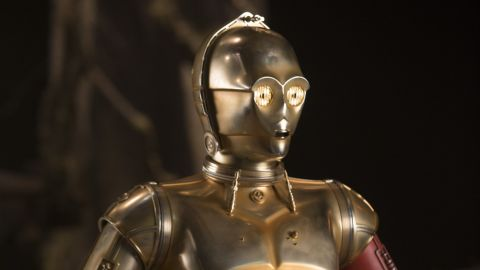 <strong>C-3PO</strong> (Anthony Daniels), back for his seventh installment in the saga, this time featuring a new red limb. He's the only actor to have had a speaking part in all of the films and ties his number of appearances with Kenny Baker (as R2-D2).