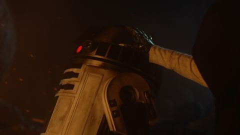 """<strong>R2-D2 </strong>(Kenny Baker), an astromech droid and """"Star Wars"""" veteran, alongside a mechanical hand. Could it be Luke? Though he's famous for playing R2, Baker also appeared as an Ewok in """"Return of the Jedi"""" and was set to play Wicket until he fell ill, opening up the chance for Warwick Davis to claim the part for his own."""