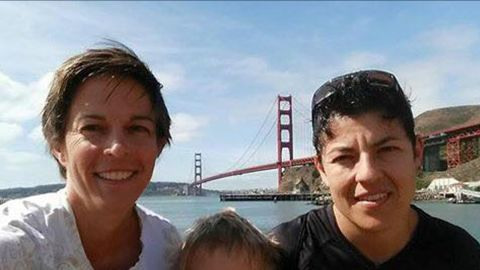 Air Force Maj. Adrianna Vorderbruggen, right, is pictured with her wife, Heather Lamb.