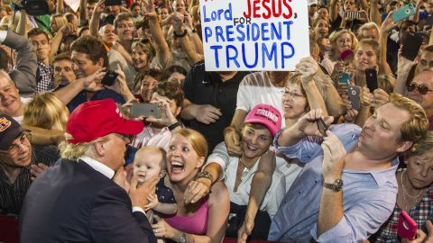 Trump greets fans after the Mobile rally, where more than 30,000 supporters from deep-red Alabama gathered in a football stadium.