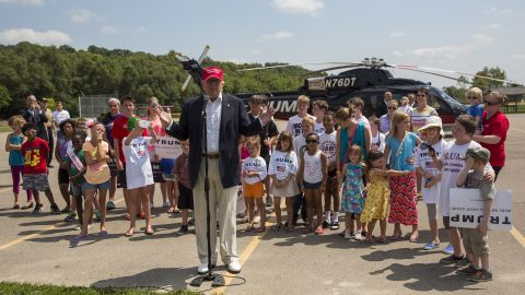 Trump speaks with reporters after arriving at the Iowa State Fair in Des Moines on August 15. Trump gave children rides on his helicopter.