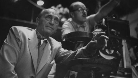 """Michael Curtiz behind the scenes during the filming of """"White Christmas,"""" a movie/musical that released January 1, 1954. Curtiz was born in Hungary on December 24, 1886. Curtiz directed many of Hollywood's most classic films, but is remembered this time of year for """"White Christmas."""""""
