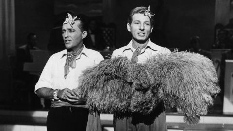 """Bing Crosby, left, and Danny Kaye perform as singers Bob Wallace and Phil Davis in a scene from the film """"White Christmas."""" The two characters are Army pals turned singer/producers after World War II."""