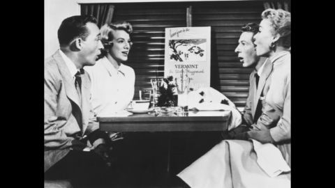 Crosby, Clooney, Kaye and Vera-Ellen sing about snow in a scene on a train.