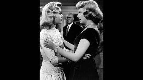 Vera-Ellen celebrates her character's engagement to Kaye's character with co-star Clooney.