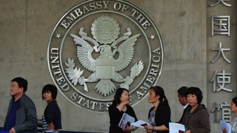 Chinese citizens wait to submit their visa applications at the US Embassy in Beijing on May 2, 2012.  AFP PHOTO/Mark RALSTON