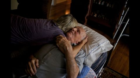 Power embraces her father in the living room of his home in Cayce.